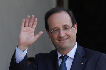 France's President Hollande waves after talks at the Elysee Palace in Paris
