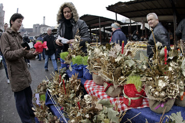 People buy traditional oak-branches, a symbol of Orthodox Christmas in Belgrade