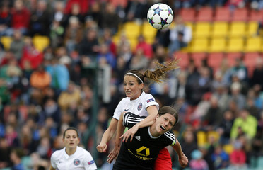 Paris St Germain's Asllani fights for the ball with FFC Frankfurt's Garefrekes during their UEFA Women's Champions League final soccer match in Berlin