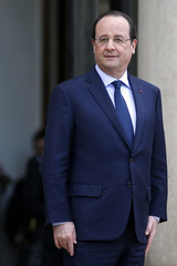 French President Francois Hollande waits for guests before a joint Franco-German cabinet meeting at the Elysee Palace in Paris