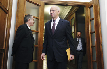 Greece's PM Papandreou arrives for a cabinet meeting inside the parliament in Athens