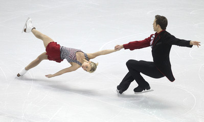 Moore-Towers and Moscovitch of Canada perform their pairs short program at the ISU World Figure Skating Championships in London