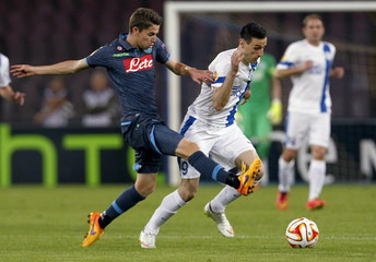 Napoli's Jorginho fights for the ball with Dnipro's Kalinic during their Europa League semi-final first leg in Naples