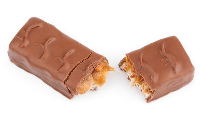 Closeup of broken chocolate bar (nougat topped with caramel, enrobed in milk chocolate) isolated on white background