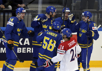 Sweden's Kronwall celebrates with team mates his goal against the Czech Republic during their Ice Hockey World Championship game at O2 arena in Prague