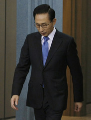 South Korean President Lee arrives to hold a news conference at the presidential house in Seoul