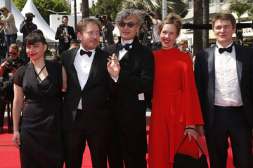 "Director Wim Wenders and his wife Donata, director Juliano Ribeiro Salgado pose on the red carpet as they arrive for the screening of the film ""Futatsume no mado"" in competition at the 67th Cannes Film Festival"