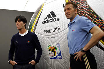 German national soccer coach Loew and assistant Koepke pose for photographers before a news conference in the Italian town of Eppan