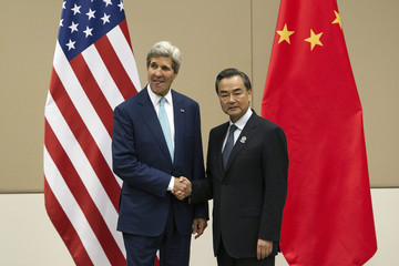 U.S. Secretary of State John Kerry shakes hands with Chinese Foreign Minister Wang Yi during a ASEAN Regional Forum at Myanmar International Convention Centre (MICC) in Naypyitaw