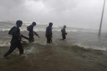 Mexican Marines patrol a beach looking for stranded residents as Hurricane Alex approaches near Bagdad beach in Matamoros