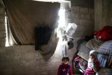 Internally displaced children rest inside a room they are currently living in, inside the rebel-held besieged eastern Ghouta of Damascus