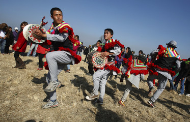 People dance to traditional music to celebrate the Udhauli festival in Kathmandu