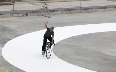 Olympic cyclist Chris Hoy takes a practice lap around the Velodrome on the Olympics 2012 site in east London