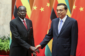 Zimbabwe's President Mugabe and China's Premier Li shake hands during their meeting at the Great Hall of the People in Beijing