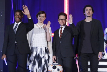 """Director Abrams, cast members Boyega, Ridley, and Driver pose for pictures during a red carpet fan event for their upcoming movie """"Star Wars: The Force Awakens"""" in Tokyo"""