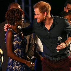 Britain's Prince Harry embraces Barbadian Sealy after she received the Queen's Young Leaders Award during a concert in Bridgetown to commemorate the 50th independence anniversary of Barbados