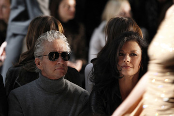 Actors Michael Douglas and Catherine Zeta-Jones attend a showing of the Michael Kors Fall/Winter 2011 collection during New York Fashion Week