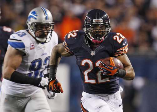 Chicago Bears running back Forte runs for extra yardage as Detroit Lions defensive end Vanden Bosch chases him down during first quarter of their NFL football game at Soldier Field in Chicago