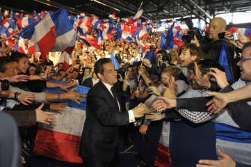 France's President and UMP party candidate for the 2012 French presidential elections Sarkozy arrives at a political rally in Villepinte