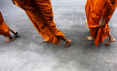 Buddhist monks walk in downtown Bangkok