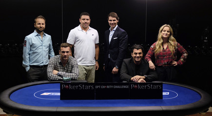 Celebrities pose for a picture before a celebrity poker tournament, the European Poker Tour Charity Challenge, in Prague