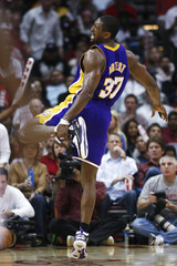 Los Angeles Lakers forward Ron Artest reacts after hurting his ankle playing against the Houston Rockets during the second half of their NBA game in Houston