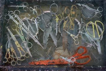 Art still life with a large number of different scissors: old scissors, medical scissors, manicure scissors.