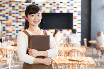 portrait of young asian waitress in cafe