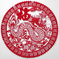 A dragon-design Chinese Lunar New Year decoration is seen on a wall in Singapore