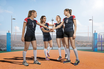 Female volleyball team celebrating victory