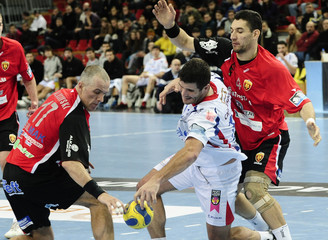 Reale Ademar's Del Pozo  tries to score past Alusevski and Stojanovic of Vardar during their handball match in Skopje