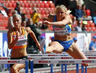 Mokhnyuk of Ukraine and Broersen of Netherlands compete in100 metres hurdles of women's heptathlon during European Athletics Championships in Zurich