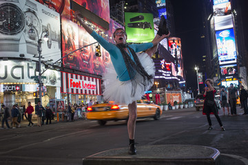 A man in a ballerina costume dances in Times Square during Halloween, in New York