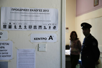 A ballot featuring Cyprus Presidential candidates is placed at the entrance of a polling station in Limassol