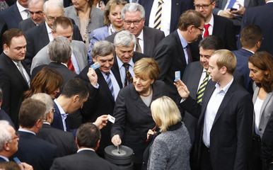 German Chancellor Merkel votes during a session of the Bundestag, the German lower house of parliament, in Berlin