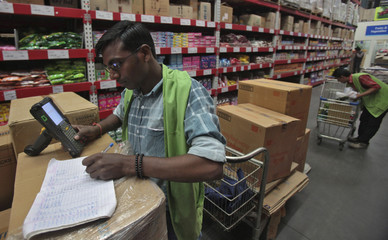 A worker tallies the stock at a Bharti Wal-Mart Best Price Modern wholesale store at Zirakpur in Punjab