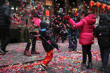 Children play with confetti during a Lunar New Year celebration in Chinatown in Manhattan, New York City, U.S.,