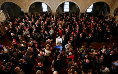 Pope Francis is welcomed as he arrives to visit the Lutheran church in Rome