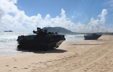Amphibious assault vehicles drive up the beach during a simulated beach assault at Marine Corps Base Hawaii with the 3rd Marine Expeditionary Unit during the multi-national military exercise RIMPAC in Kaneohe, Hawaii.
