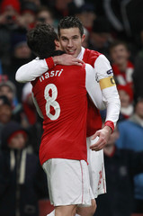 Arsenal's Robin Van Persie celebrates his goal against Partizan Belgrade during their Champions League soccer match in London