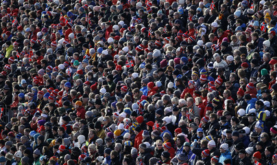 Spectators attend the men's cross country 50 km mass start free event at the Nordic World Ski Championships in Oslo