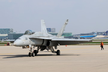 A F/A 18C (VFA - 106) from Naval Air Station, Oceana in Virginia sits on the tarmac during media day for the Canadian International Air Show at Pearson Airport in Toronto