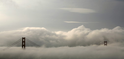 Fog envelops the Golden Gate Bridge in San Francisco, California