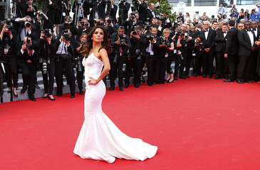 """Actress Eva Longoria poses on the red carpet as she arrives for the screening of the film """"Saint Laurent"""" in competition at the 67th Cannes Film Festival in Cannes"""