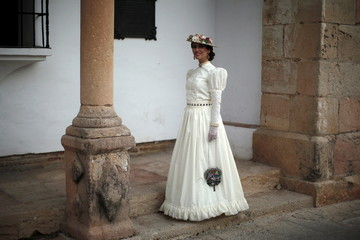 "Perez Clotet, dressed as a bourgeois, poses for a photo as she participates in the third edition of ""Ronda Romantica"" (Romantic Ronda) in Ronda"