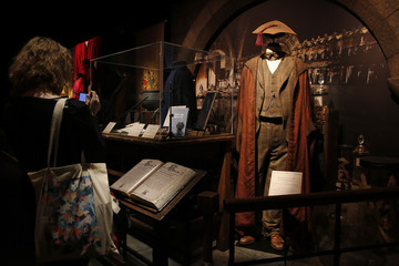 """A visitor takes pictures inside """"Harry Potter: The Exhibition"""" during the press visit in Saint-Denis, near Paris"""