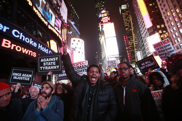 Protesters shout slogans in Times Square, New York