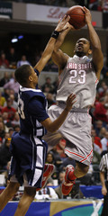 Ohio State's Lighty shoots on Penn State's Frazier during a men's Big Ten tournament championship game in Indianapolis