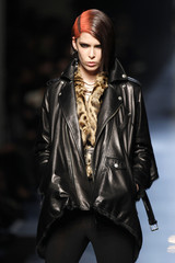 A model presents a creation by French designer Jean Paul Gaultier as part of his Fall/Winter 2012-2013 women's ready-to-wear show during Paris fashion week