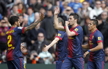 Barcelona's David Villa celebrates a goal with his team-mates during their Spanish First division soccer league match against Getafe in Barcelona
